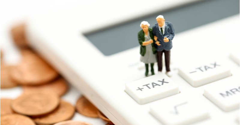 Retired couple contemplating tax rules