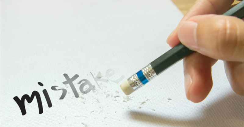 """The word """"Mistake"""" is being erased by a hand holding a pencil eraser. The word fades out where it was erased."""