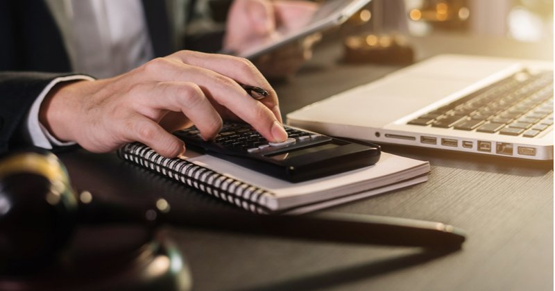 lawyer using calculator