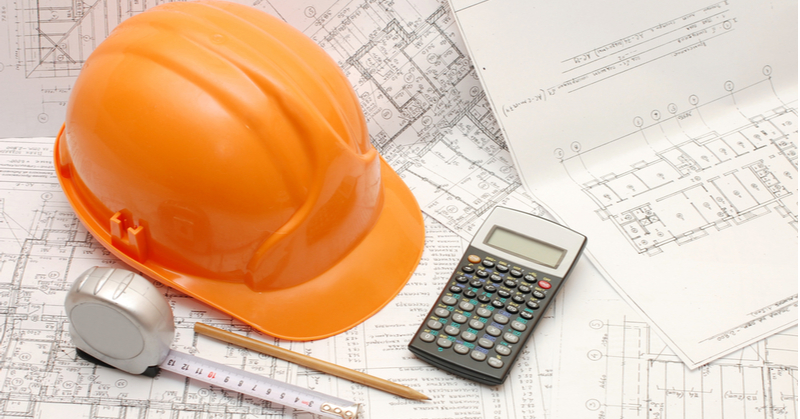 Hard hat, calculator, percentage of completion accounting, construction